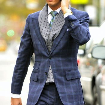 A very dapper Scott Disick chats on his cellphone and hails a cab in New York City.